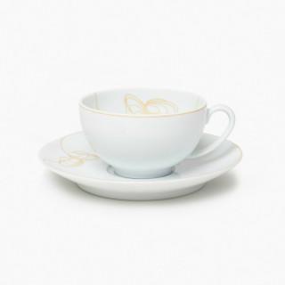 Une tasse et soucoupe à thé, collection l' Art du Thé